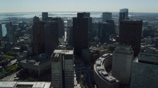 AX142_025 - 6K stock footage aerial video flying by skyscrapers, Boston City Hall, Downtown Boston, Massachusetts