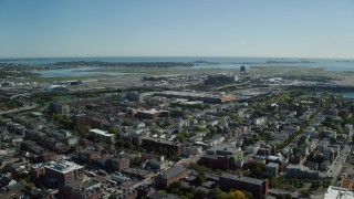 AX142_027 - 6K stock footage aerial video approaching, flying over Logan International Airport, East Boston, Massachusetts