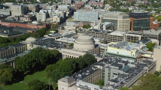 AX142_055 - 6K stock footage aerial video flying by Massachusetts Institute of Technology, Cambridge, Massachusetts