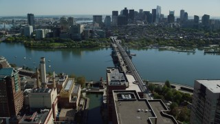 AX142_064 - 6K stock footage aerial video approaching Longfellow Bridge, Downtown Boston, Cambridge, Massachusetts