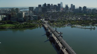 AX142_065 - 6K stock footage aerial video flying over Longfellow Bridge, approach Beacon Hill, Downtown Boston, Massachusetts