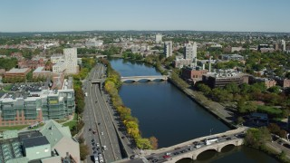 AX142_078 - 6K stock footage aerial video flying over Charles River, approaching bridges, Cambridge, Massachusetts
