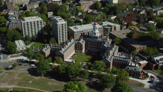 AX142_095 - 6K stock footage aerial video orbiting, flying away from Harvard University, Cambridge,  Massachusetts