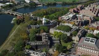 AX142_100 - 6K stock footage aerial video orbiting Harvard University and Eliot House, Cambridge, Massachusetts