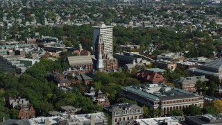 AX142_102 - 6K stock footage aerial video of Harvard University, Widener Library, Memorial Church, Cambridge, Massachusetts