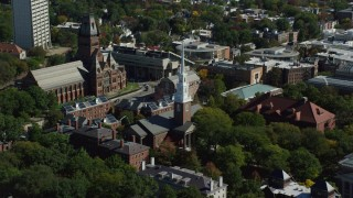 AX142_103 - 6K stock footage aerial video flying by Harvard University, Memorial Church, Cambridge, Massachusetts