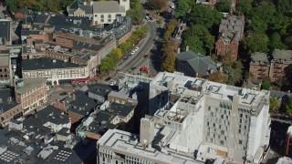 AX142_109 - 6K stock footage aerial video orbiting Harvard University, Harvard Square, Cambridge, Massachusetts