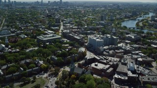 AX142_113 - 6K stock footage aerial video orbiting Harvard University, revealing Charles River, Cambridge, Massachusetts