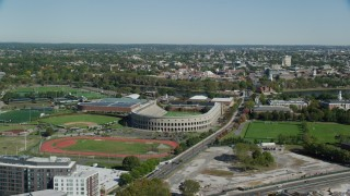 AX142_118 - 6K stock footage aerial video panning right by Harvard Stadium, Harvard University, Cambridge, Massachusetts