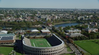 AX142_120 - 6K stock footage aerial video flying over Harvard Stadium, approach Harvard University, Cambridge, Massachusetts