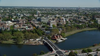 AX142_121 - 6K stock footage aerial video flying over Anderson Memorial Bridge, Harvard University, Cambridge, Massachusetts
