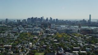 AX142_124 - 6K stock footage aerial video flying over Cambridge and by Downtown Boston, Massachusetts