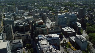 AX142_137 - 6K stock footage aerial video flying by Longwood Medical Area, approaching power plant, Boston, Massachusetts