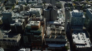 AX142_138 - 6K stock footage aerial video of Longwood Medical Area, tilt down over power plant, Boston, Massachusetts