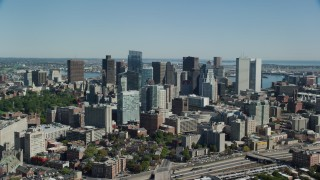 AX142_151 - 6K stock footage aerial video approaching, flying by skyscrapers, Downtown Boston, Massachusetts