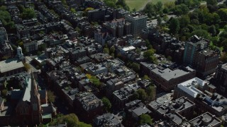 AX142_155 - 6K stock footage aerial video flying over row houses, tilt down, Beacon Hill, Downtown Boston, Massachusetts
