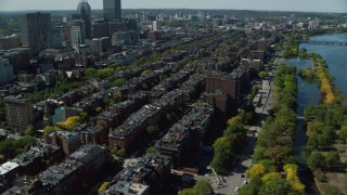 AX142_158 - 6K stock footage aerial video flying by Victorian brownstones, Back Bay, Downtown Boston, Massachusetts