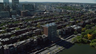 AX142_159 - 6K stock footage aerial video flying by Victorian brownstones, pan left, Back Bay, Downtown Boston, Massachusetts