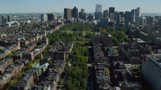 AX142_165 - 6K stock footage aerial video of Victorian brownstones, Boston Common, Back Bay, Downtown Boston, Massachusetts