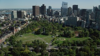 AX142_166 - 6K stock footage aerial video flying over Boston Common, approaching Downtown Boston, Massachusetts