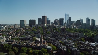 AX142_174 - 6K stock footage aerial video flying over parks, approaching Beacon Hill, Downtown Boston, Massachusetts