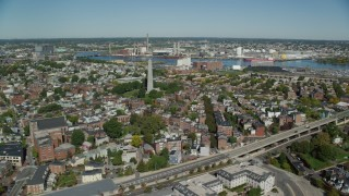 AX142_178 - 6K stock footage aerial video flying by row houses, Bunker Hill Monument, Charlestown, Massachusetts