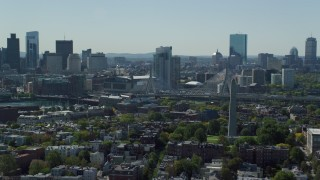 AX142_180 - 6K stock footage aerial video of Bunker Hill Monument, Downtown Boston skyline, Charlestown, Massachusetts