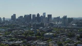 AX142_181 - 6K stock footage aerial video of Bunker Hill Monument, Downtown Boston skyline, Charlestown, Massachusetts