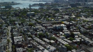 AX142_182 - 6K stock footage aerial video flying by Bunker Hill Monument, row houses, Charlestown, Massachusetts