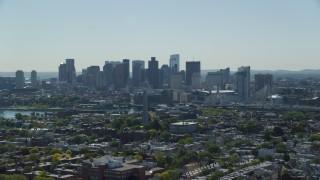 AX142_185 - 6K stock footage aerial video of Bunker Hill Monument, Downtown Boston skyline, Charlestown, Massachusetts