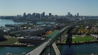 AX142_188 - 6K stock footage aerial video of Tobin Memorial Bridge, Downtown Boston skyline, Charlestown, Massachusetts