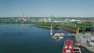 AX142_189 - 6K stock footage aerial video flying by Tobin Memorial Bridge, Mystic River, Charlestown, Massachusetts