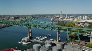 AX142_190 - 6K stock footage aerial video panning left by Tobin Memorial Bridge, Mystic River, Charlestown, Massachusetts