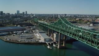 AX142_191 - 6K stock footage aerial video panning by Tobin Memorial Bridge, Mystic River, approach Charlestown, Massachusetts
