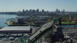 AX142_192 - 6K stock footage aerial video of Tobin Memorial Bridge, Downtown Boston skyline, Charlestown, Massachusetts