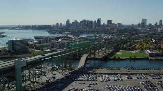 AX142_193 - 6K stock footage aerial video of Tobin Memorial Bridge, Downtown Boston skyline, Charlestown, Massachusetts