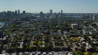 AX142_194 - 6K stock footage aerial video flying by Bunker Hill Monument, apartments, houses, Charlestown, Massachusetts