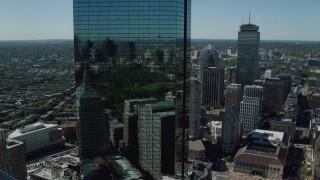 AX142_202 - 6K stock footage aerial video of John Hancock Tower, skyscrapers, Downtown Boston, Massachusetts