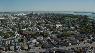 AX142_206 - 6K stock footage aerial video of Neighborhoods, Dorchester Heights Monument, South Boston, Massachusetts