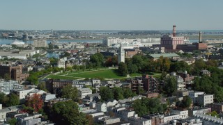 AX142_207 - 6K stock footage aerial video flying by Dorchester Heights Monument, South Boston, Massachusetts