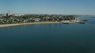 AX142_208 - 6K stock footage aerial video flying by coastal community, South Boston, Massachusetts