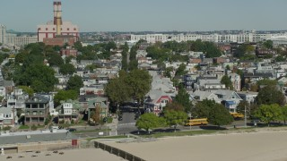AX142_211 - 6K stock footage aerial video flying by beachfront homes, South Boston, Massachusetts