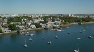 AX142_213 - 6K stock footage aerial video flying by piers, anchored boats, South Boston, Massachusetts