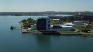 AX142_217 - 6K stock footage aerial video orbiting the John F. Kennedy Presidential Library, Boston, Massachusetts