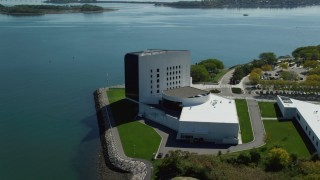 AX142_218 - 6K stock footage aerial video orbiting the John F. Kennedy Presidential Library, Boston, Massachusetts