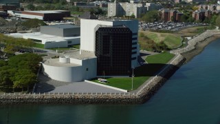 AX142_222 - 6K stock footage aerial video orbiting the John F. Kennedy Presidential Library, Boston, Massachusetts