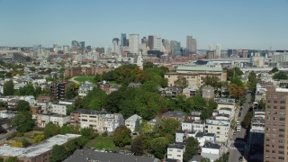 AX142_226 - 6K stock footage aerial video of Dorchester Heights Monument, South Boston, Downtown Boston, Massachusetts
