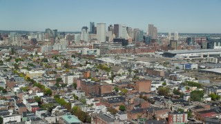 AX142_228 - 6K stock footage aerial video flying over neighborhoods, approaching Downtown, South Boston, Massachusetts