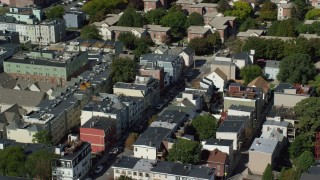 AX142_229 - 6K stock footage aerial video flying by row houses, streets, South Boston, Massachusetts