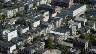AX142_233 - 6K stock footage aerial video flying by residential neighborhoods, tilt down, South Boston, Massachusetts